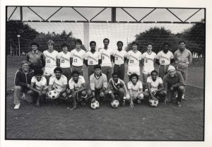 1984 Mens Soccer Team in front of a goal